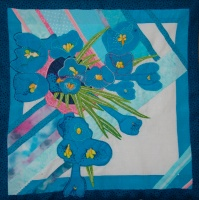 Textile version of a mixed media drawing of crocus in a pink pot