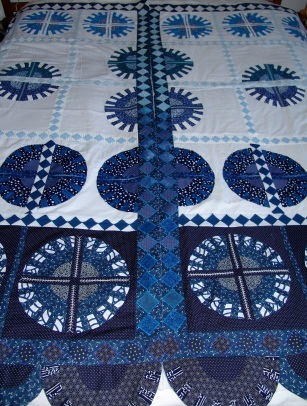 Quilted blinds with appliqué New York Beauty motif
