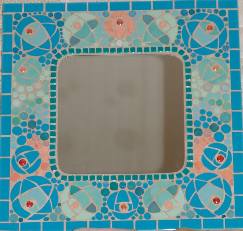 Variation on Mackintosh rose on mirror frame