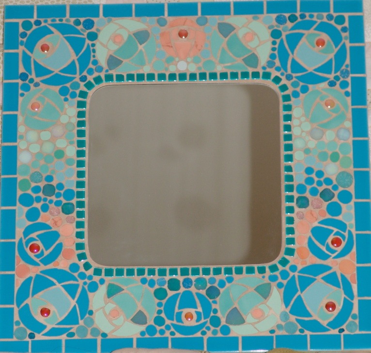 Variation on Mackintosh rose on mirror frame