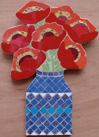 Red poppies in Japanese blue vase